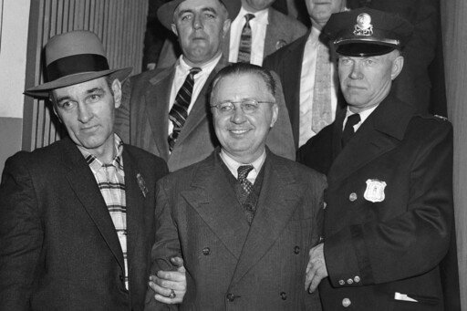 "Police arresting ""Mad Bomber"" George Metesky at his sister's home."