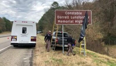 Sign identifying  a portion of U.S. Highway 59 as the Darrell Lunsford, Sr. Memorial Highway
