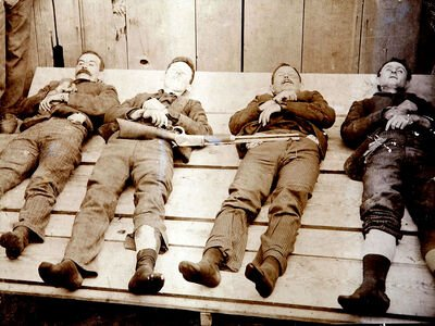 Four members of the Dalton Gang lie dead after the ill-fated Coffeyville robbery. Left to Right: Bill Power, Bob Dalton, Grat Dalton, Dick Broadwell (Cramers Art Rooms of Cherryvale, Kansas)