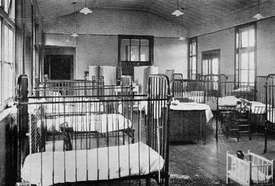 Ward CH3, Queen's Park Hospital. June Devaney slept is the cot second from left. Note white footprints on the waxed floor.