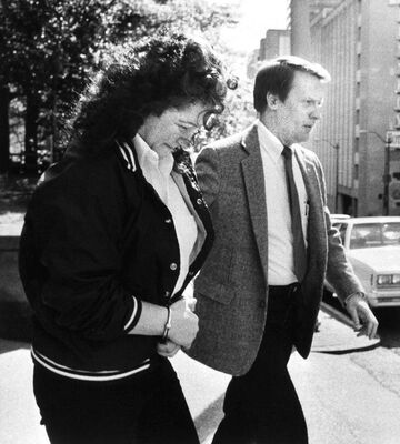 May 9, 1988, U.S. Marshall Merry Moore leads Stella Nickell from the federal courthouse after a jury convicts her on five counts of product tampering.