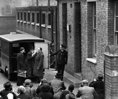 A police van delivers John Christie to court for trial