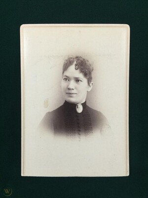 """Mary Jane """"May"""" Killeen. This 1880s cabinet photograph is part of a collection of Tombstone prostitutes, making it likely she wasn't just a hotel chambermaid."""