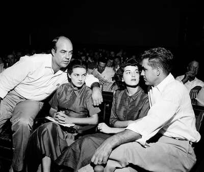 J.W. Milam (L) and Roy Bryant (R) sit with their wives in the courtroom in Sumner, Mississippi on September 23, 1955.