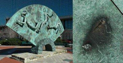 Shrapnel damage (R) to Olympic Park sculpture